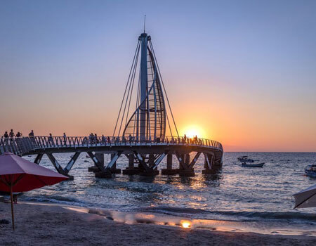 If visiting Puerto Vallarta, try to see a sunset from Los Muertos Pier.