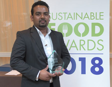 Thusitha Bandara, Company General Manager of Sustainability and R&D with the award in Amsterdam.