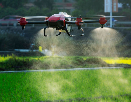 An XAG drone spraying crops with pesticides (Photo courtesy of XAG)