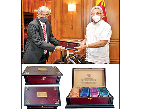 George Steuart Teas Managing Director Dai Pathmanathan hands over the Ceylon Tea gift boxes to President Gotabaya Rajapaksa