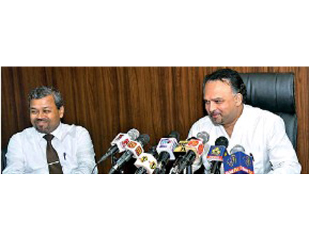 From left: Secretary to the Ministry of Plantation Industries, J.A. Ranjith and Plantation Industries Minister Navin Dissanayake PIC BY KUSHAN PATHIRAJA