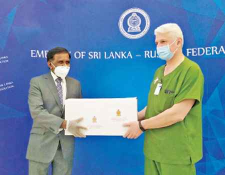 Ambassador Designate of Sri Lanka to the Russian Federation, Prof. M.D. Lamawansa handing over a consignment of Ceylon Tea to Deputy Chief Physician Dr. Igor Tyurin of the Kommunarka Hospital.